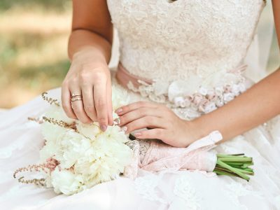 woman bride holding a beautiful bouquet flowers